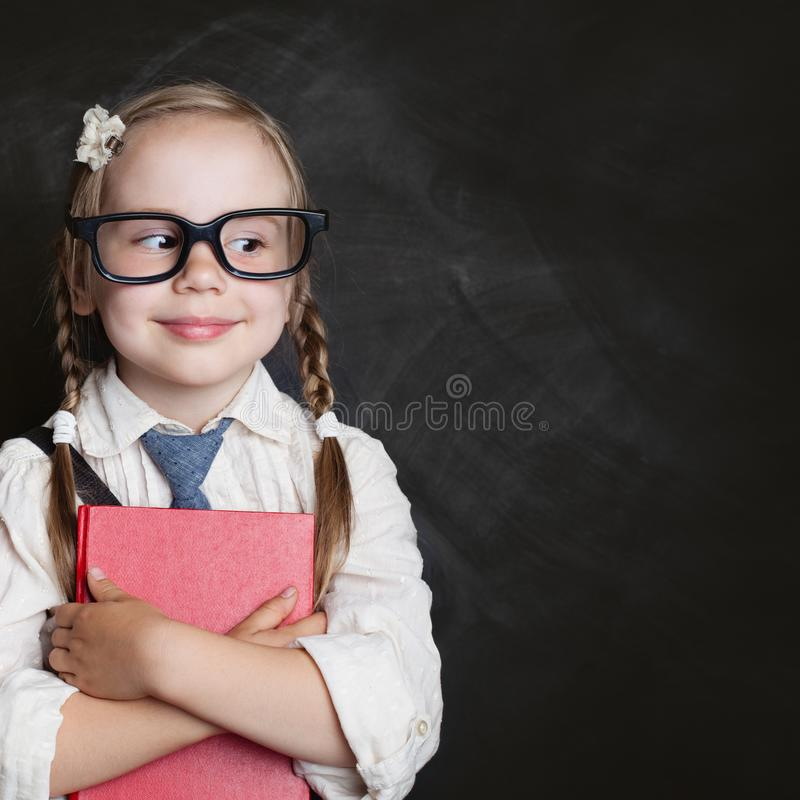 Kids education and child reading concept. Cute child girl royalty free stock photo