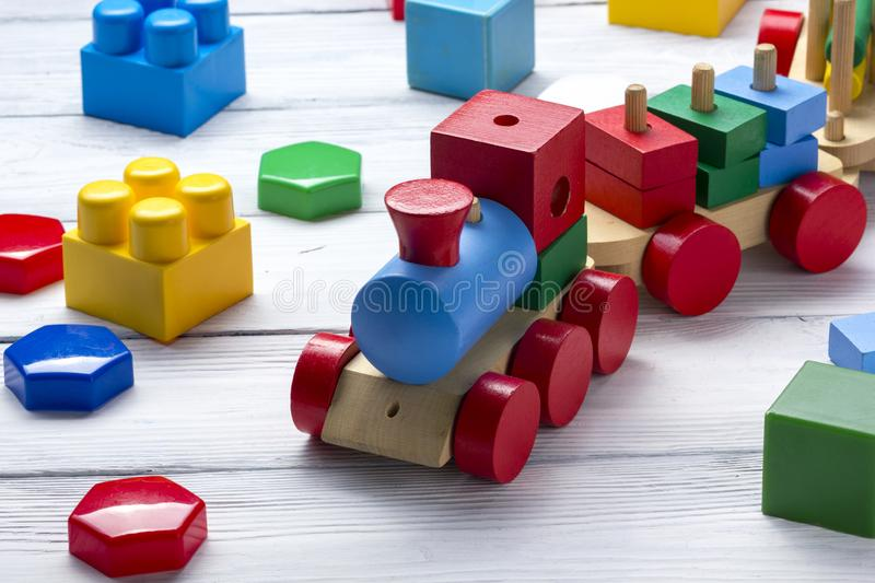 Kids educational developing toys frame on white background. Top view. Flat lay. Copy space for text stock photos