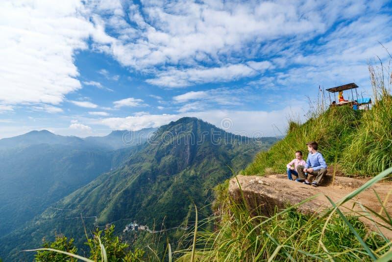Ella gap views. Kids enjoying breathtaking views over mountains and tea plantations from Little Adams peak in Ella Sri Lanka stock image