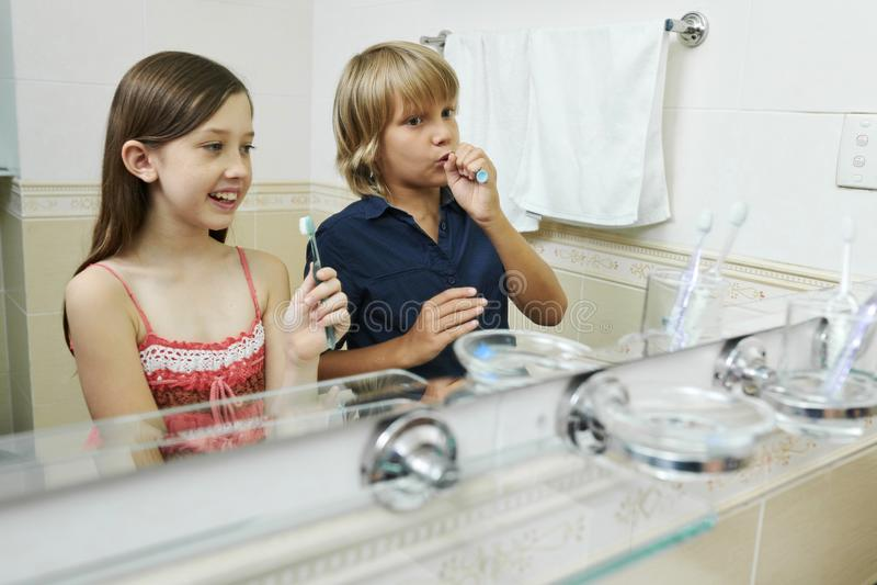 Kids enjoying brushing teeth stock image