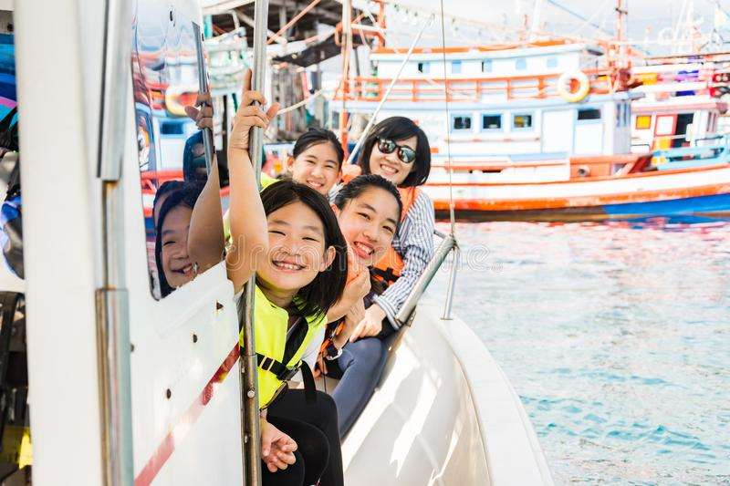 Kids are enjoying the ocean during riding on boat royalty free stock photos