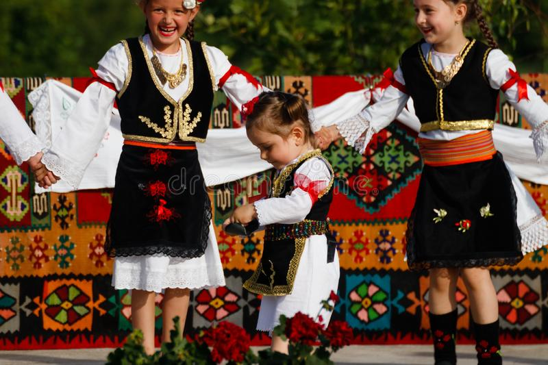 Kids enjoying the parade in traditional costumes of Vojvodina, Serbia royalty free stock images