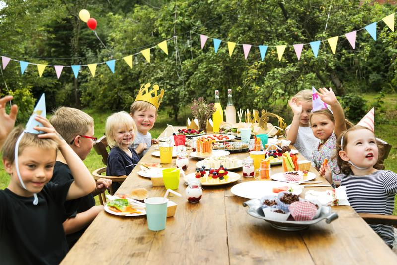 Kids enjoying party in the garden royalty free stock photo