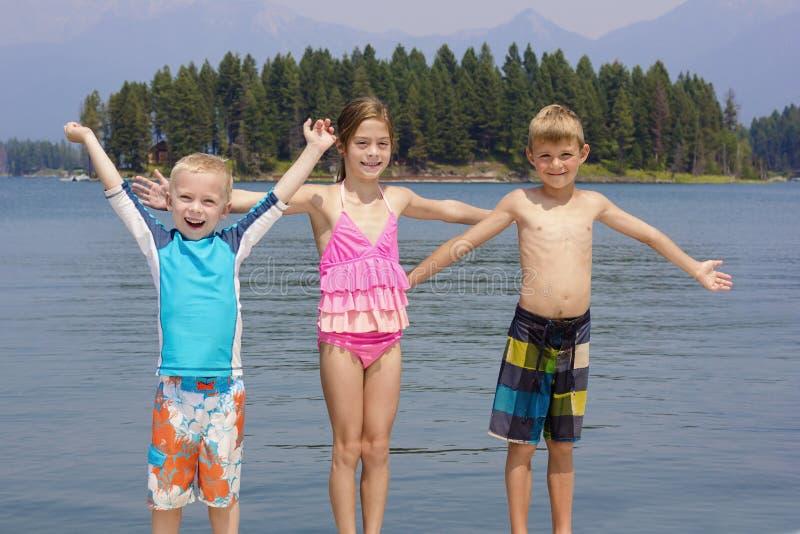 Kids Enjoying Summer Vacation At The Lake Stock Photo