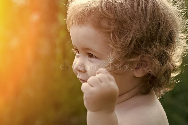 Kids enyoj happy day. Playful boy outdoor royalty free stock images