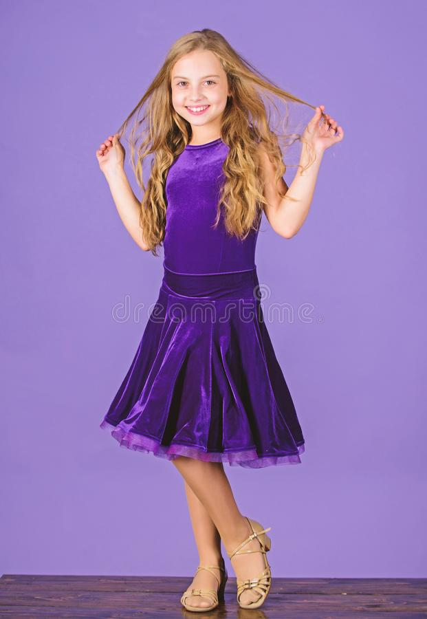 Kids fashion. Kid fashionable dress looks adorable. Ballroom dancewear fashion concept. Kid dancer satisfied with. Concert outfit. Girl cute child wear velvet royalty free stock image