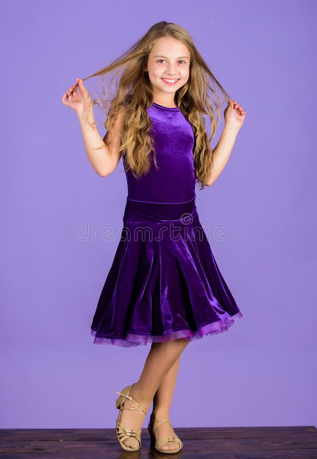 Kids fashion. Kid fashionable dress looks adorable. Ballroom dancewear fashion concept. Kid dancer satisfied with. Concert outfit. Girl cute child wear velvet stock images