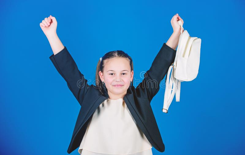 Kids fashion trend concept. Schoolgirl formal style clothes with small cute backpack. Do not forget your backpack. Learn. How fit backpack correctly. Girl royalty free stock image
