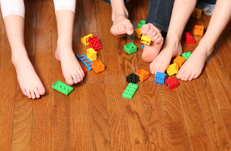 Kids feet pickup up blocks