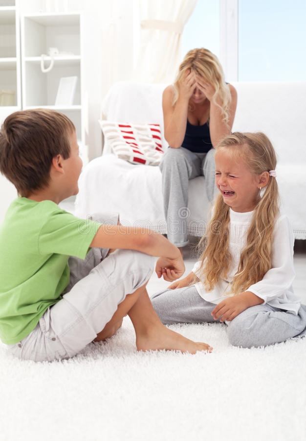 Kids fighting and crying stock image