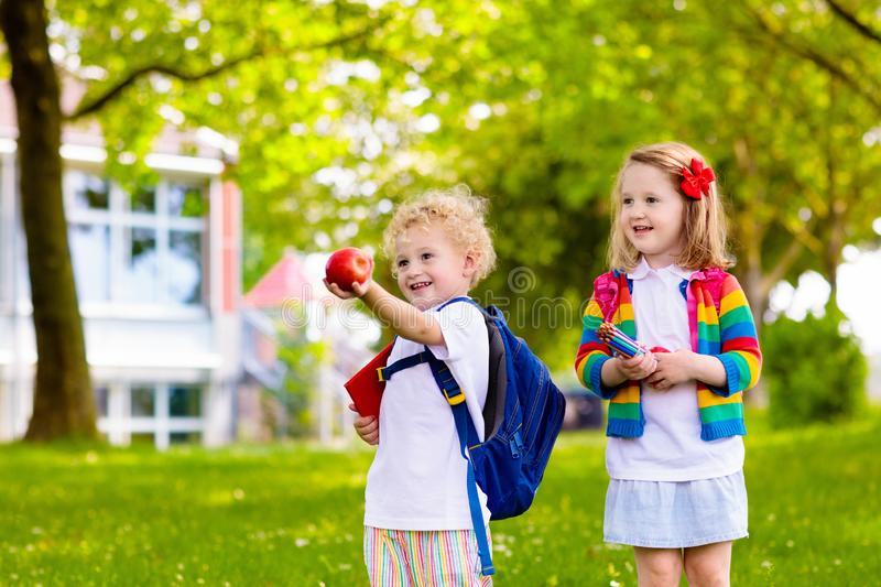 Kids on first school day. Child going to school. Boy and girl holding books and pencils on the first school day. Little students excited to be back to school royalty free stock photography