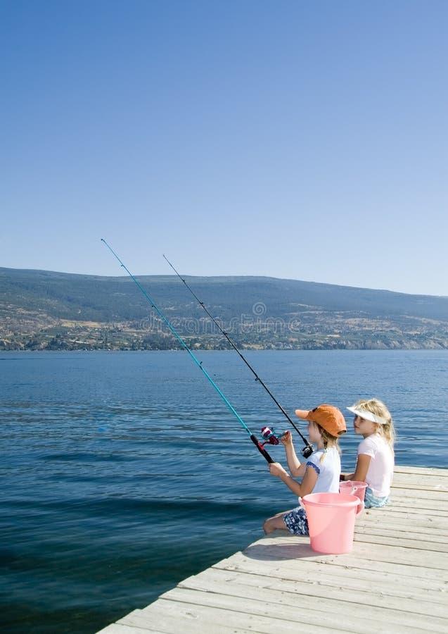 Kids fishing in lake royalty free stock photo