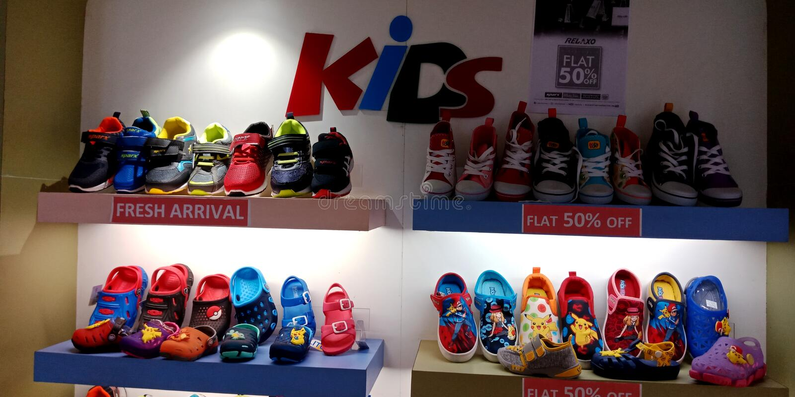 Kids footwear showcase at shoes store royalty free stock image
