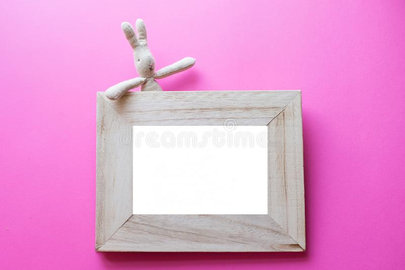 Kids Frame for photos with children toy on pink background. birthday frame royalty free stock images