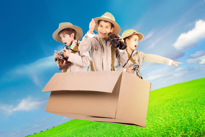 Kids in a game drive. Children in a cardboard box playing Safari stock photos