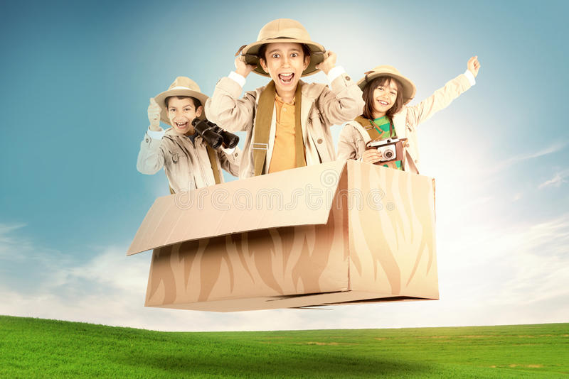 Kids in a game drive. Children in a cardboard box playing Safari stock images