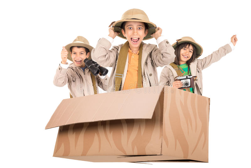 Kids in a game drive. Children in a cardboard box playing Safari royalty free stock image