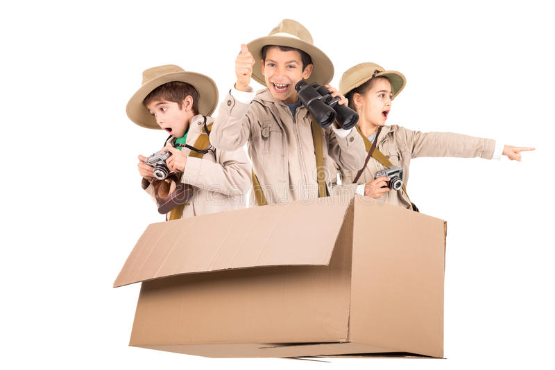 Kids in a game drive. Children in a cardboard box playing Safari royalty free stock photography