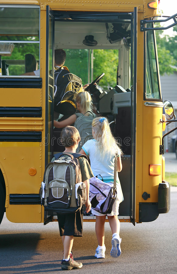 Download Kids Getting on School Bus stock image. Image of friend - 3058523