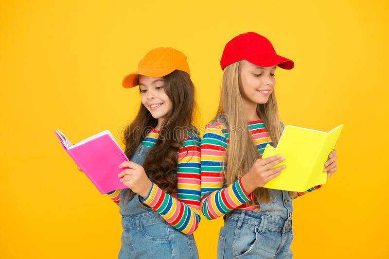 Kids girls with books study together. Back to school. Learning foreign languages. Effective study groups help students. Learn material deeper. Study group can royalty free stock images