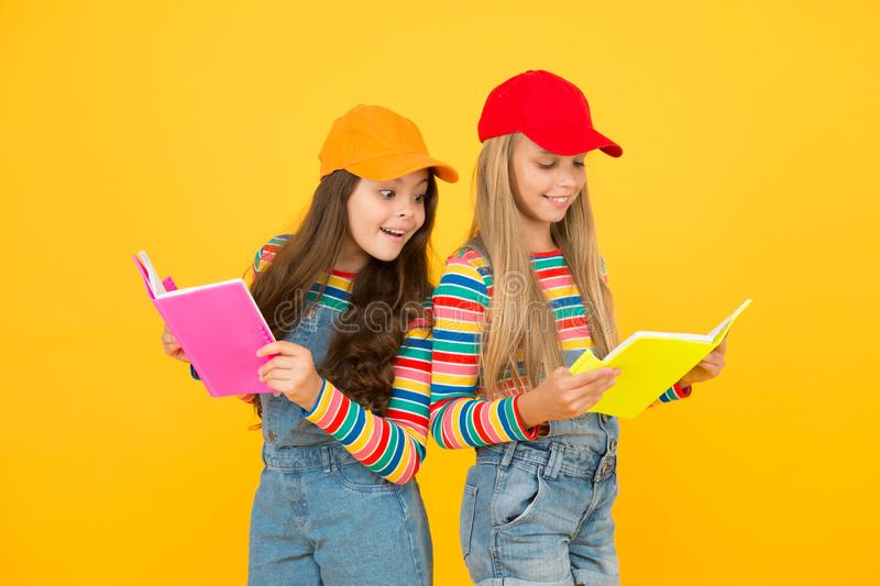 Kids girls with books study together. Study group can help solidify and clarify material. Back to school. Learning. Foreign languages. Effective study groups royalty free stock photos
