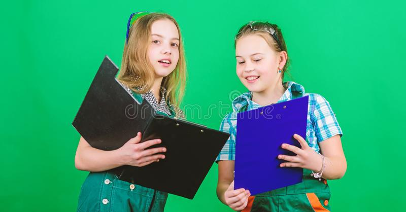 Kids girls planning renovation. Initiative children girls provide renovation their room green background. Child care stock photography