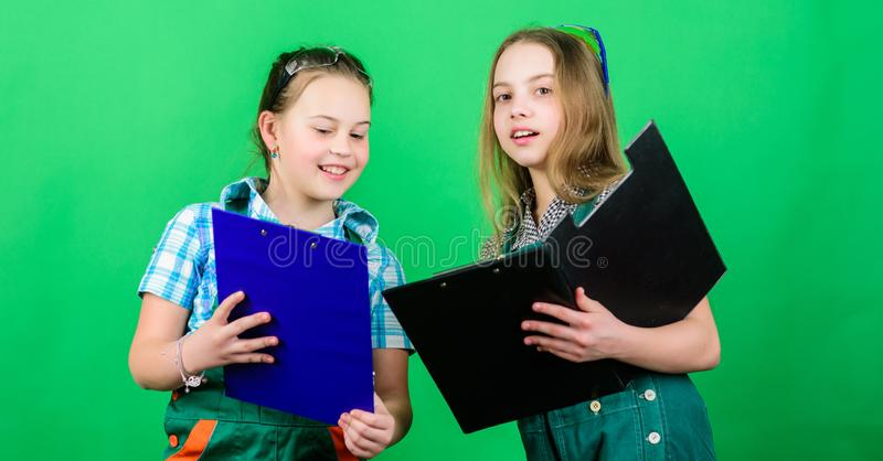 Kids girls planning renovation. Initiative children girls provide renovation their room green background. Child care. Renovation plan. Builder engineer stock photos