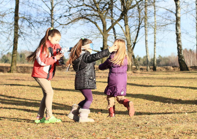 Kids - girls playing blind man's buff stock image