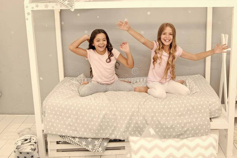 Kids girls sisters best friends full of energy in cheerful mood. Good morning concept. Great start of day. Children. Cheerful play bedroom. Happy childhood royalty free stock photos