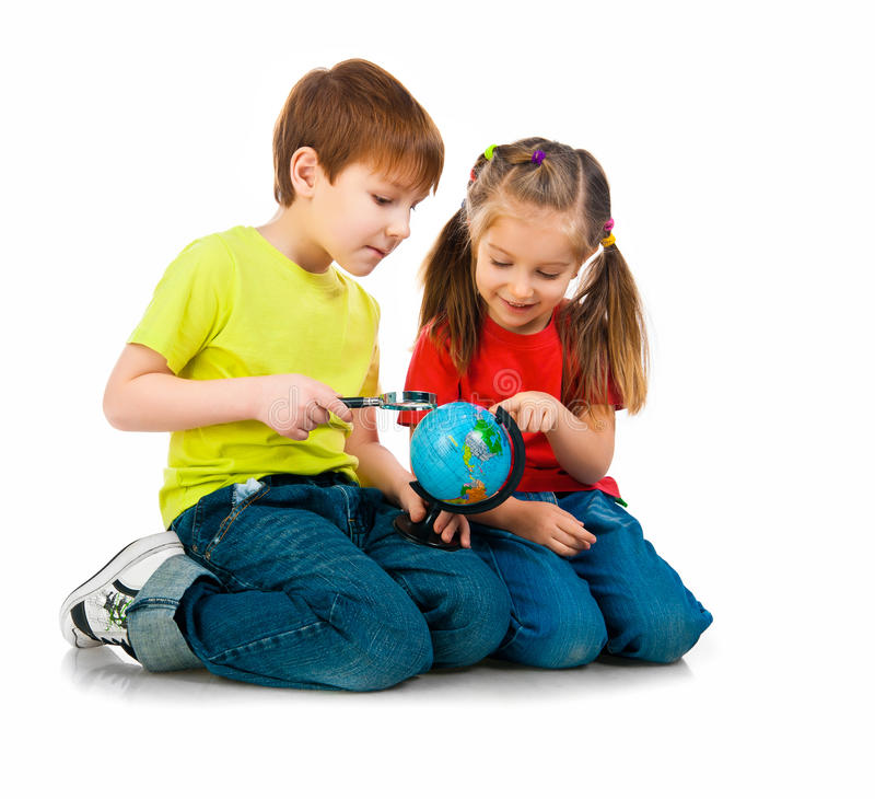 Kids with a globe of the world. Over white background royalty free stock photography