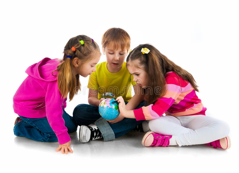 Kids with a globe of the world. Over white background royalty free stock images