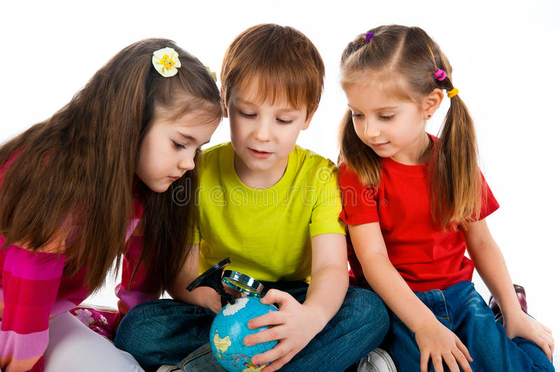Kids with a globe of the world. Over white background royalty free stock image