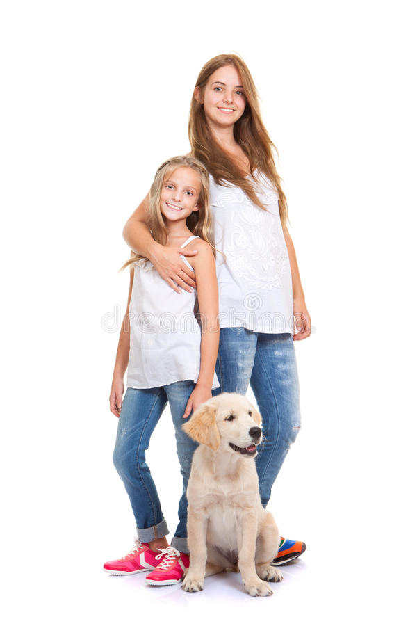 Kids with golden labrador, retriever puppy stock photo