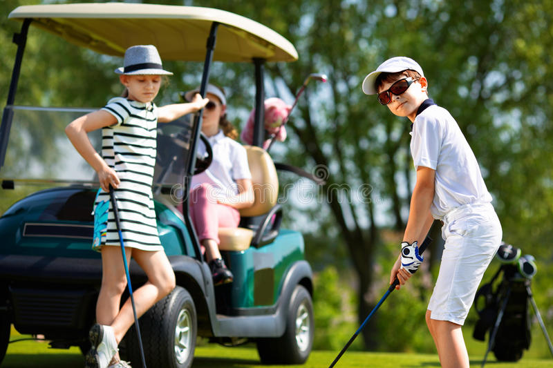 Kids golf competition stock images