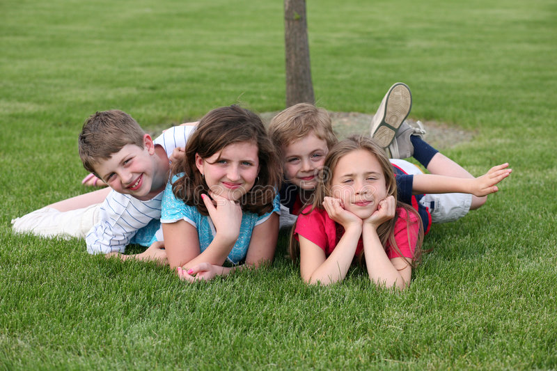 Kids in the Grass royalty free stock photos