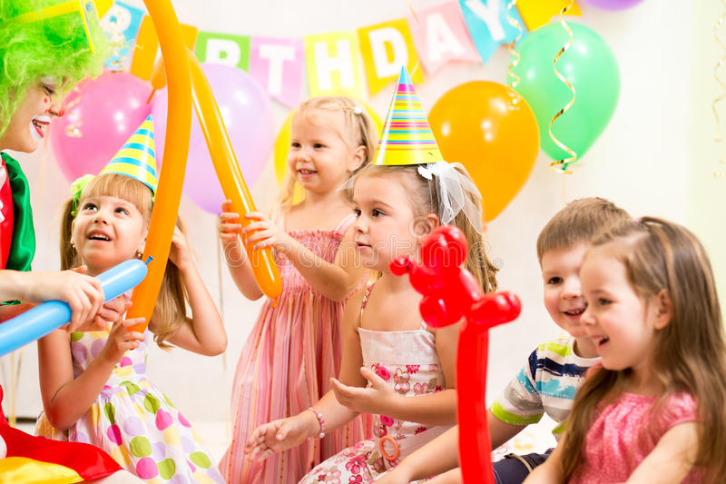 Kids group and clown on birthday party stock photography