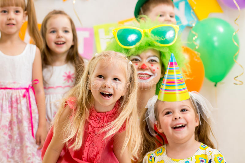 Kids group and clown on birthday party royalty free stock photo