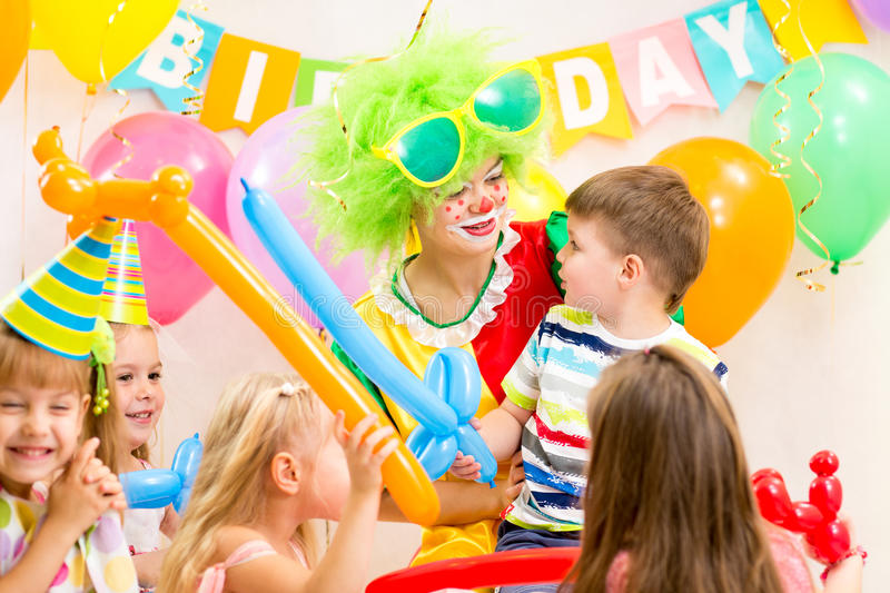 Download Kids Group And Clown Celebrating Birthday Party Stock Photo - Image: 34560872