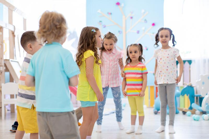 Kids group have fun and play at kindergarden stock photo