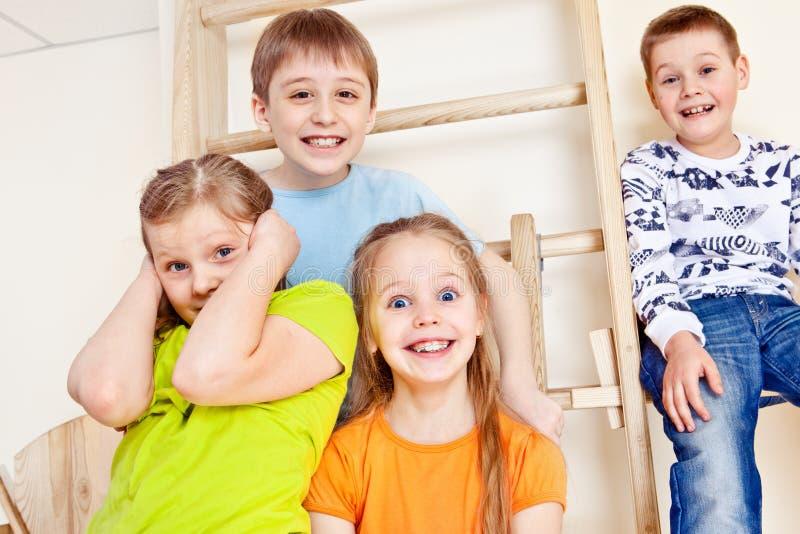 Kids group on wall bars royalty free stock image
