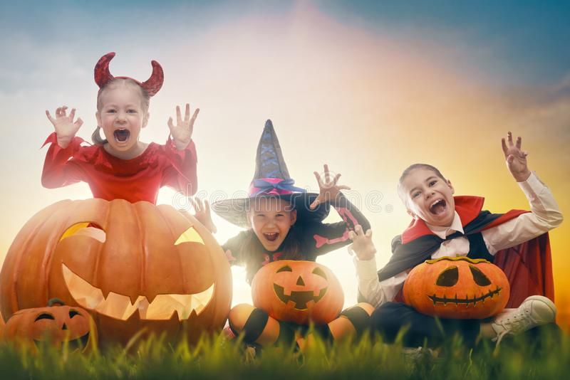 Kids in Halloween carnival costumes stock photography