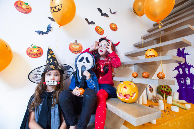 Kids in halloween costumes. Children in monster costumes have fun on a Halloween holiday royalty free stock images