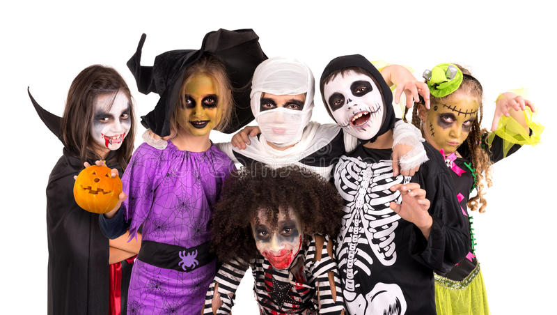 Kids in Halloween costumes. Kids with face-paint and Halloween costumes isolated in white stock photos