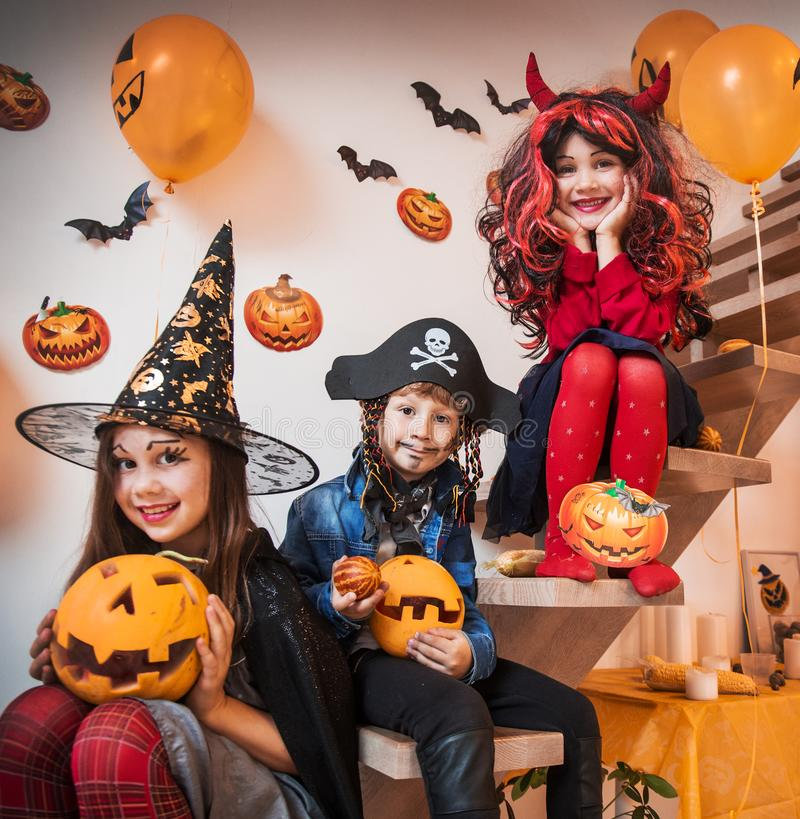 Kids in Halloween party stock images