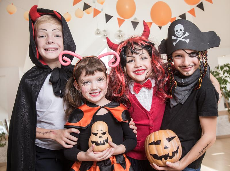Kids in Halloween party. Group of funny children in costume celebrate together a halloween party royalty free stock image