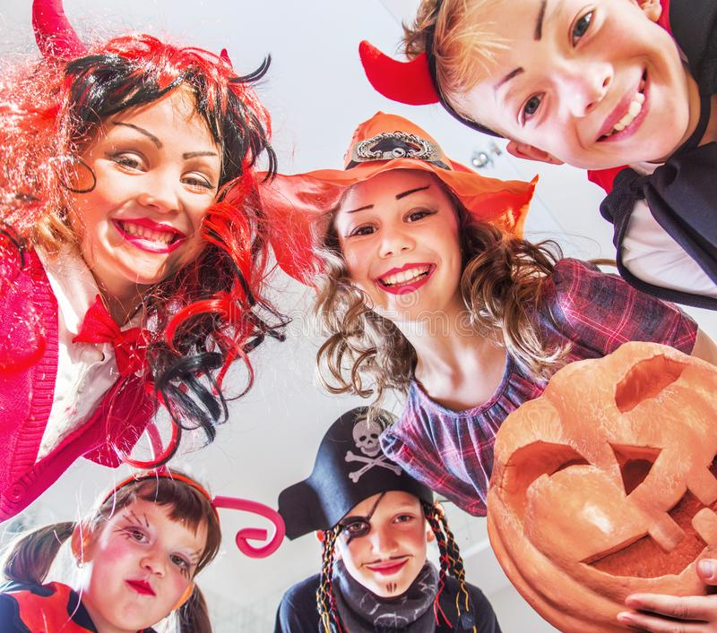 Kids in Halloween party. Group of funny children in costume celebrate together a halloween party royalty free stock photography