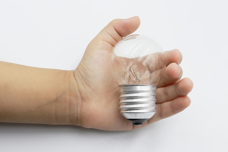 Kids hand holding a light bulb isolated on white background stock photos