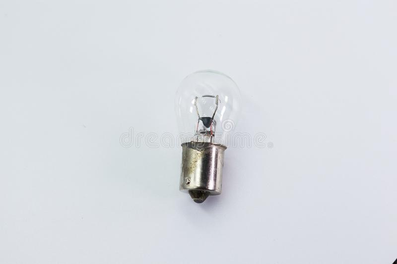 Kids hand holding a light bulb isolated on white background royalty free stock images