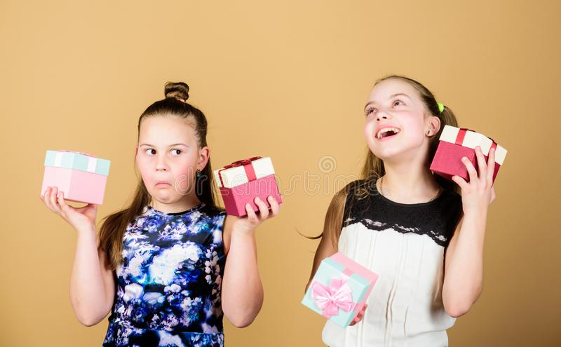 Kids happy loves birthday gifts. Shopping and holidays. Sisters enjoy presents. Children hold gift boxes beige royalty free stock photo