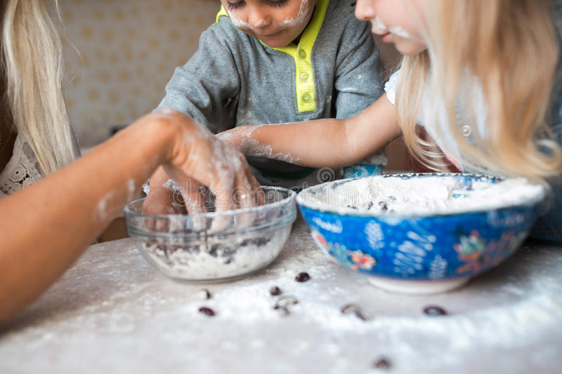 Kids have fun with kids at kitchen stock photos